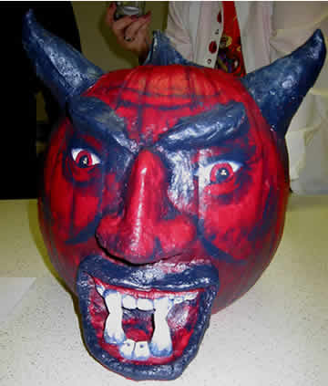 pumpkin decorating contest at his job. The devil won first prize in